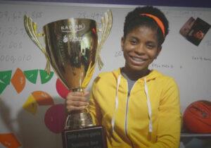 zaila avant-garde posing with spelling bee trophy